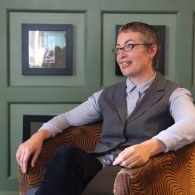 Image of Kate Clanchy sat in chair at the Midland Hotel