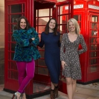 Image of Laura Dockrill, Julie Mayhew & Sarah Crossan posing in front of two telephone boxes