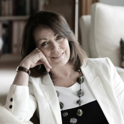 Image of Rose Tremain dressed all in black and white, with a large beaded necklace