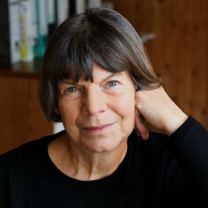 Image of Margaret Drabble looking straight at the camera with her head resting on her hand