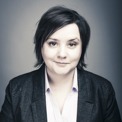 Image of Susan Calman with one eyebrow slightly raised and half a smile
