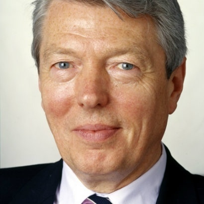 Image of Alan Johnson dressed in a suit and tie
