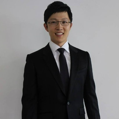 Image of Sungju Lee from the waist up, dressed in a formal suit and tie and smiling