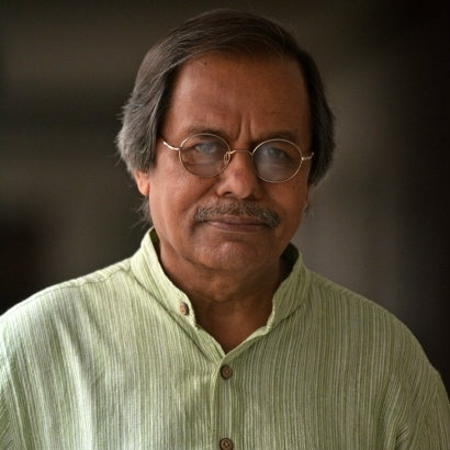 Image of Professor Syed Manzoorul Islam in a light-weight green shirt