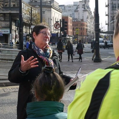 Image of Anne Beswick leading a walking tour around Manchester