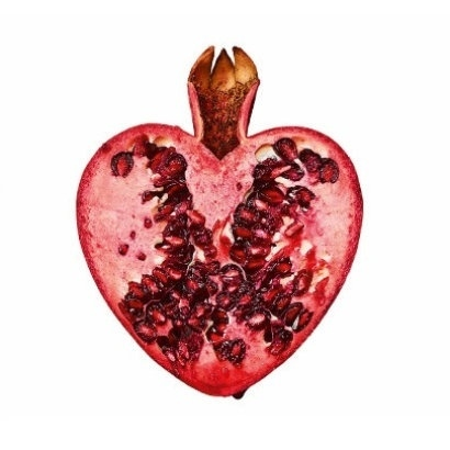 Image of the front cover of Reader, I Married Him showing a pomegranate cut in half in the shape of a heart, on a white background