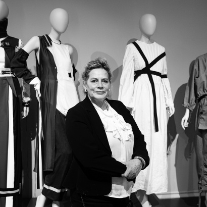 Author Deborah Levy in front of mannequins at the Manchester Art Gallery exhibition Fashion and Freedom in 2016