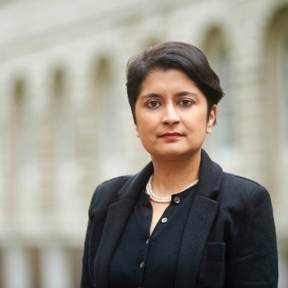 Photo of human rights activist and author Shami Chakrabarti with a building behind her