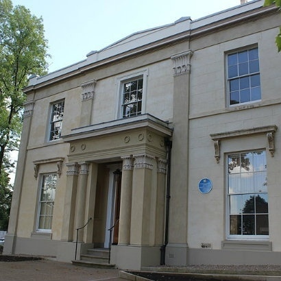 Image of the cream stone facade of Elizabeth Gaskell's house in Plymouth Grove