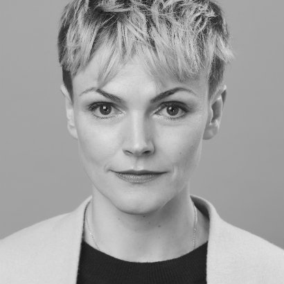 Image of Maxine Peake with short hair, looking straight to camera