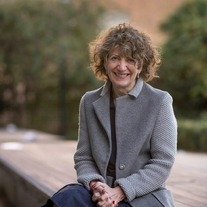 Author and psychotherapist Susie Orbach against a backdrop of trees