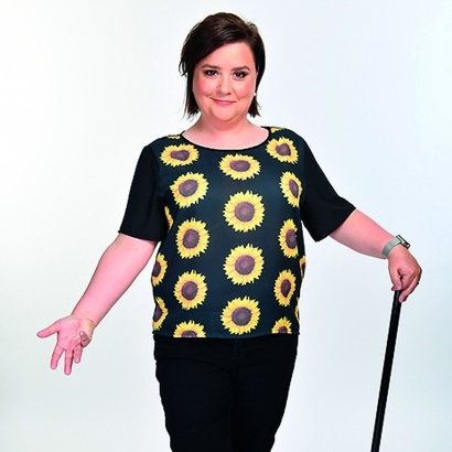 Writer and comedian Susan Calman in a dance pose with cane