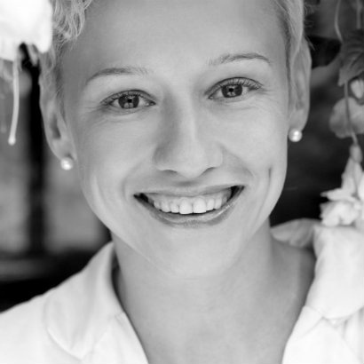 Black and white headshot of author Dace Ruksana