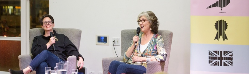 Image of host Erica Wagner on stage with author Barbara Kingsolver
