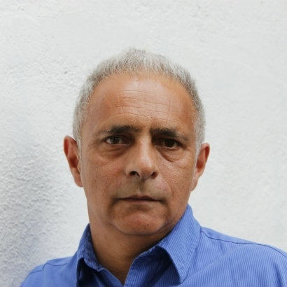 Headshot of author Hanif Kureishi