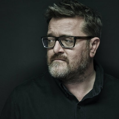 Headshot of musician and presenter Guy Garvey