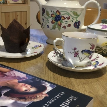 Image of tea table with book