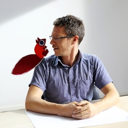 Image of children's author CHris Haughton with a cartoon squirrel on his shoulder