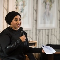 Image of poet Hafsah Aneela Bashir performing at the MLF 19 Launch Event