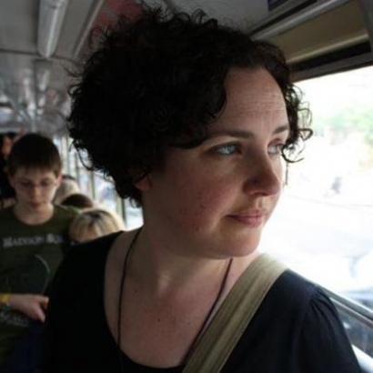 North West writer Michelle Green staring thoughtfully out of the window on her travels.