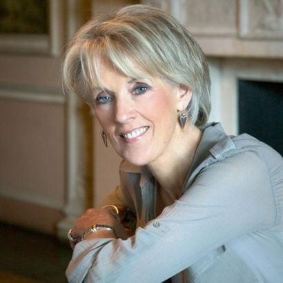 Acclaimed author Joanna Trollope infront of a period fireplace.