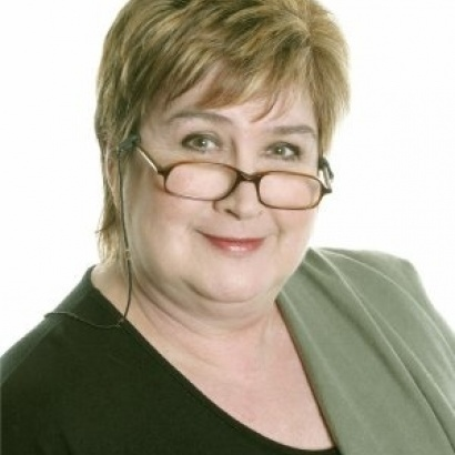 Author and Woman's hour presenter Jenni Murray with glasses perched on her nose.
