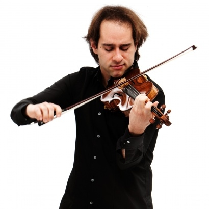 Manchester Camerata band leader Giovanni Guzzo playing the violin.