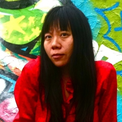 Chinese author and film=maker Xiaolu Guo in a bright red top.