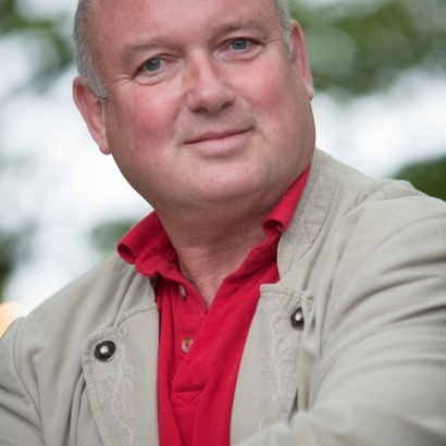Acclaimed author Louis de Bernieres smiling joyfuly.