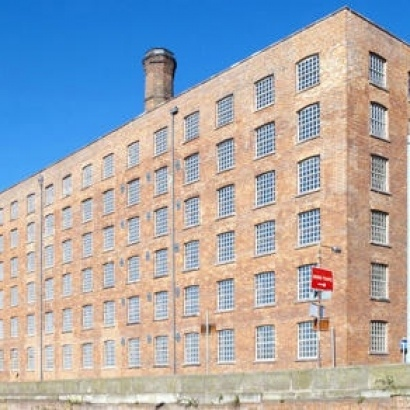 Photo of Murrays Mill, a large industrial brick mill in Ancoats and the setting for several literary books