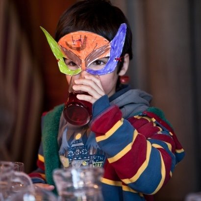 A child in a hand coloured mask from the family reading day in 2012