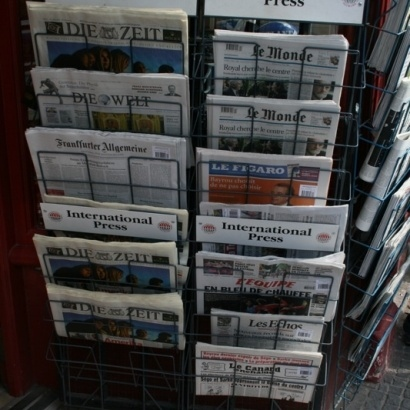 Picture of Newspapers on a rack outside a shop